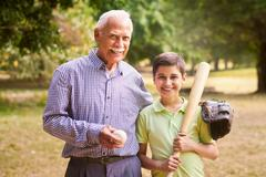 Portrait Happy Family Grandfather and Boy Playing Baseball - stock photo