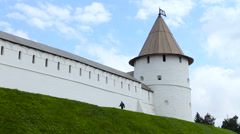 Man Comes Near South-West Tower and Kul Sharif Mosque of Kazan Kremlin. Kazan, Stock Footage