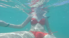 beautiful girls swimming in cyan water. summer and vacation. active lifestyle. - stock footage
