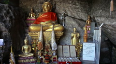 Sitting into cave gold Buddha sculpture slider's motion, Luang Prabang, Laos Stock Footage