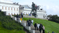 People Climb the Stairs Behind Monument to Musa Jalil Near the Kazan Kremlin. Stock Footage
