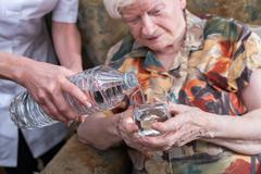 Home assistance of seniors - stock photo