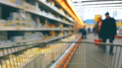Supermarket mall interior with customers and trolley, blurred background Stock Footage