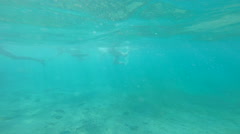 beautiful people swimming in cyan water. summer and vacation. active lifestyle. - stock footage