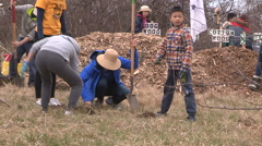 Students plant trees on Earth Day in Markham Canada v61 Stock Footage