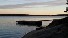 Sunset at a wharf at the beautiful archipelago of Raasepori, Uusimaa, Finland Stock Footage