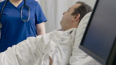 Physician giving instructions to hospital patient - stock footage