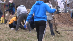 Students plant trees on Earth Day in Markham Canada v62 Stock Footage