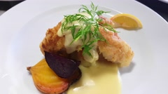 Battered perch filet dishes, with, dill, golden beetroot, potatoes and hollan - stock footage