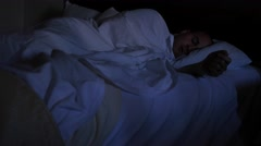 A man sleeping in a hotel bed - stock footage