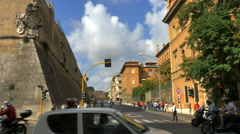 Busy intersection traffic Rome Italy by corner of Vatican fortress Stock Footage