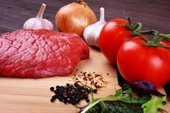 Raw Beef Roast with Fresh Herbs - stock photo