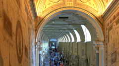 Crowds of visitors throng corridor St Peters Basilica Vatican City Stock Footage