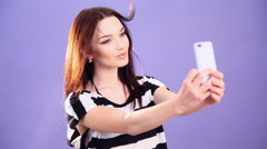 Girl takes pictures of yourself on your phone Stock Footage