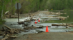 River spilling over roadway Stock Footage