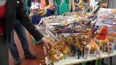 Tourist picking souvenir in Marakesh Marakech market Stock Footage