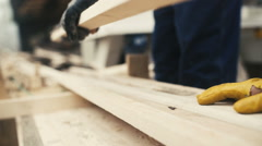 Man working with wood at sawmill Stock Footage