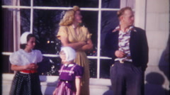 3226 the family gathers outdoors for Christmas photo - vintage film home movie Stock Footage