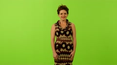 woman smile to camera greenscreen ms 4K - stock footage