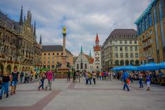 Munich, Germany - July 30, 2015: Famous city hall building with its tall towe Stock Photos