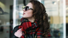 Beautiful professional model in sunglasses posing on camera - stock footage