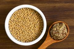 Yellow Mustard Seeds and Whole Grain Mustard Stock Photos