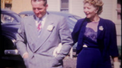 Well dressed couple arrive at the family party - 3229 vintage film home movie Stock Footage