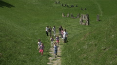 Group of little kids running through the valley, crane shot by Sheyno. - stock footage