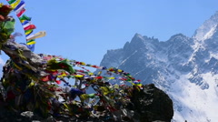 Prayer flags shken by the wind at  Himalaya Nepal Stock Footage