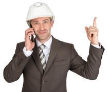 Architect talking on phone and raising finger up Stock Photos