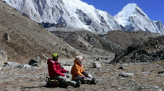 Trekkers resting at Khumbu glacier High Himalaya mountain, Nepal Stock Footage