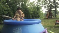 Family In Swimming Pool In Backyard Stock Footage