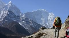 Trekkers hiking at High Himalaya mountain Stock Footage