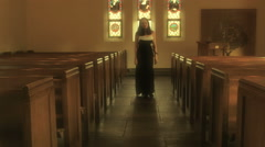 Young Woman In Church Praying Stock Footage