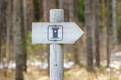 WC signpost in forest - stock photo