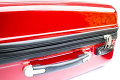 Locked and zip closed of red suitcase - stock photo