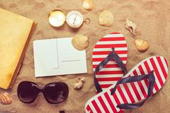 Beach ready, summer holiday vacation accessories on sandy beach - stock photo