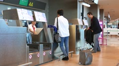 Airline passengers checking in the Valencia, Spain Airport. Stock Footage