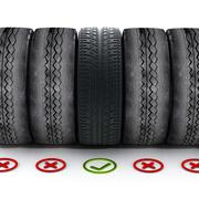 New car tire with green check mark standing out among old tires - stock illustration