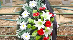cemetery crosses funeral, wreaths and tsyeta - stock footage