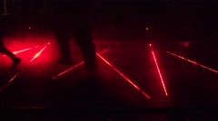 Laser beams used in security demonstration at night. 4K Stock Footage