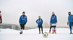 Penalty Shoot-Out in Winter Soccer Match Stock Footage