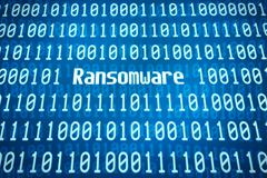 Binary code with the word Ransomware in the center Kuvituskuvat