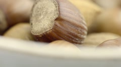 Mixed nuts with nutshells in bowl Stock Footage