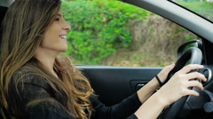 Young woman driving happy listening music moving hair slow motion Stock Footage
