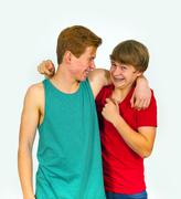 Brothers make jokes together and have fun together Stock Photos