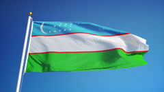 Uzbekistan flag in slow motion seamlessly looped with alpha - stock footage