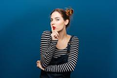 Amusing attractive young woman showing silence gesture Stock Photos