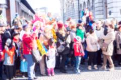 Blurred crowd looking at street performance Stock Photos