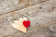 Love hearts  hanging on wooden background. - stock photo